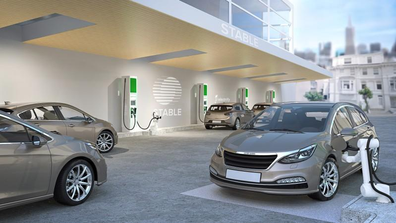 Future charging facility for autonomous vehicles using Stable robotics and Electrify America chargers is seen in an artist's rendering