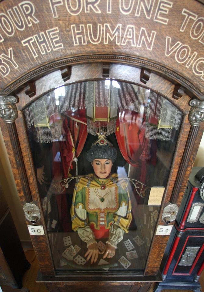 This July 28, 2011, photo shows an antique Gypsy fortune teller machine, that sat for decades in this Virginia City, Mont., restaurant and has received a multimillion dollar offers from curators including magician David Copperfield. Collectors say the 100-year-old machine that speaks your fortune may be the last of its kind. (AP Photo/Michael Albans)