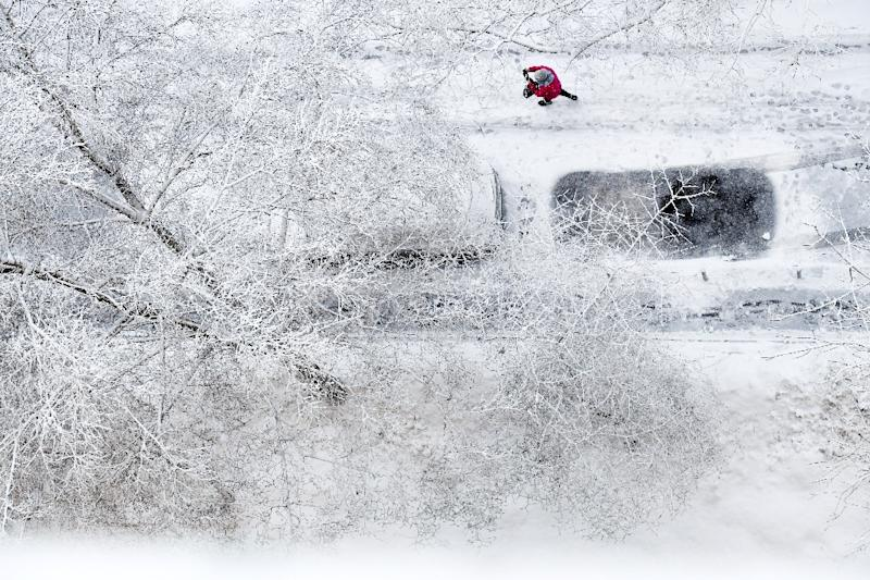 Some seven centimetres (2.8 inches) of snow fell overnight, according to the national meteorological service, with drifts reaching up to 45 centimetres (18 inches).  (AFP Photo/Kirill KUDRYAVTSEV)