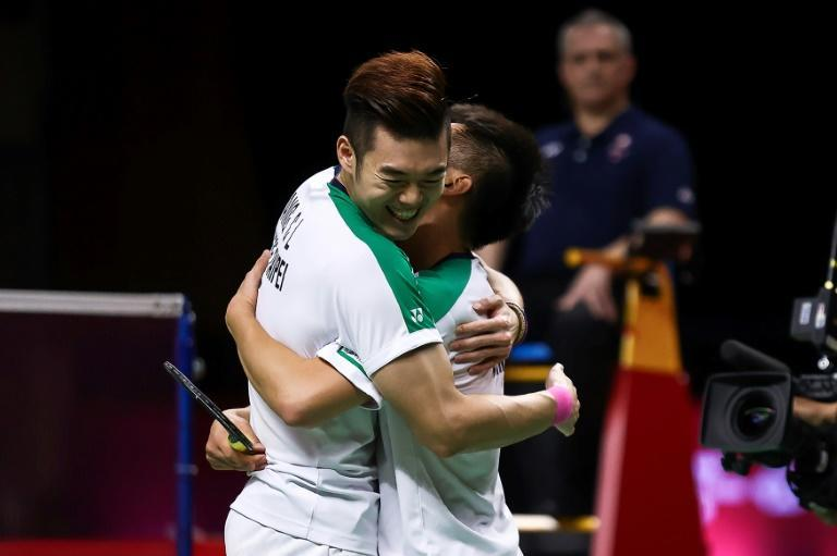 Taiwan's Wang Chi-lin (L) celebrated with partner Lee Yang after winning their men's doubles final match on Sunday