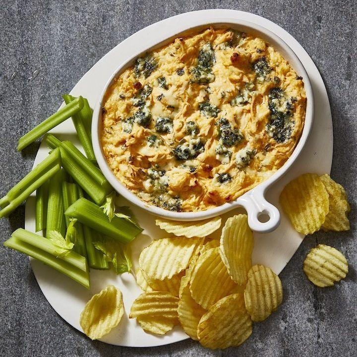 "<p>This warm bowl is bound to please your Super Bowl party guests — and you can make it up to a day ahead, so <em>you</em> have more time to cheer on your team.</p><p><em><a href=""https://www.goodhousekeeping.com/food-recipes/a19738/buffalo-chicken-dip/"" rel=""nofollow noopener"" target=""_blank"" data-ylk=""slk:Get the recipe for Buffalo Chicken Dip »"" class=""link rapid-noclick-resp"">Get the recipe for Buffalo Chicken Dip »</a></em></p><p><strong>RELATED: </strong><a href=""https://www.goodhousekeeping.com/food-recipes/easy/g28422681/best-tailgate-food/"" rel=""nofollow noopener"" target=""_blank"" data-ylk=""slk:50 Easy Recipes for the Best Tailgate Food Around"" class=""link rapid-noclick-resp"">50 Easy Recipes for the Best Tailgate Food Around</a></p>"