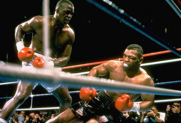 Buster Douglas KO10 Mike Tyson, Feb. 10, 1990 – Tyson was a 42-1 favorite to defend his IBF/WBA/WBC heavyweight titles, but he was in trouble right from the start. He had a powerful jab that he kept popping in Tyson's face. Tyson dropped Douglas in the eighth, nearly saving his title, but Douglas came back strong. He hit Tyson with an uppercut and then a series of shots, that dropped Tyson. Tyson was unable to get up and suffered his first, and most stunning, defeat.