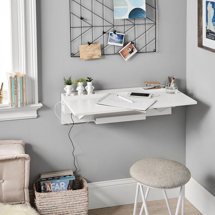 "The more [minimalist] the merry — you can easily tuck this unencumbered floating desk style into any room's decor scheme with incognito ease.<br><br><em><strong><a href=""https://go.skimresources.com/?id=30283X879131&isjs=1&jv=14.3.0-stackpath&sref=https%3A%2F%2Fwww.refinery29.com%2Fen-us%2Ffloating-furniture-decor%23slide-12&url=https%3A%2F%2Fwww.pbteen.com%2Fproducts%2Fusb-wall-desk%2F&xguid=01EBE9NVHDENCV4PAETFKKEZBJ&xs=1&xtz=240&xuuid=e97027bb5dbf478b0db8042b13b2c70a&xjsf=other_click__contextmenu%20%5B2%5D"" rel=""nofollow noopener"" target=""_blank"" data-ylk=""slk:Shop Pottery Barn"" class=""link rapid-noclick-resp"">Shop Pottery Barn</a></strong></em><br><br><strong>Pottery Barn Teen</strong> USB Wall Desk, $, available at <a href=""https://go.skimresources.com/?id=30283X879131&url=https%3A%2F%2Fwww.pbteen.com%2Fproducts%2Fusb-wall-desk%2F"" rel=""nofollow noopener"" target=""_blank"" data-ylk=""slk:Pottery Barn"" class=""link rapid-noclick-resp"">Pottery Barn</a>"