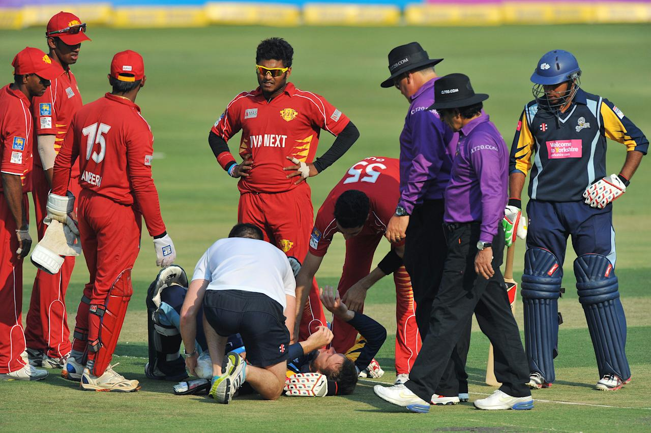 JOHANNESBURG, SOUTH AFRICA - OCTOBER 09:  David Miller of Yorkshire receives medical attention after being struck by a bouncer from Umar Gul during the Karbonn Smart CLT20 pre-tournament Qualifying Stage match between Yorkshire (England) and Uva Next (Sri Lanka) at Bidvest Wanderers Stadium on October 09, 2012 in Johannesburg, South Africa.  (Photo by Duif du Toit/Gallo Images/Getty Images)