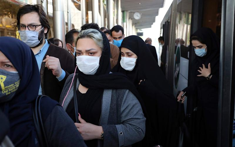 People wear protective face masks to help prevent the spread of the coronavirus in downtown Tehran, Iran - AP Photo/Ebrahim Noroozi