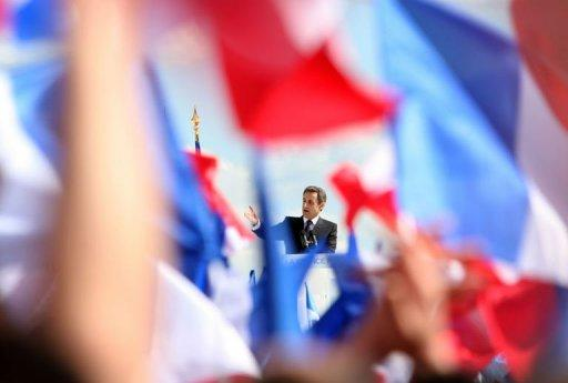 French President Nicolas Sarkozy delivers a speech during a campaign meeting at the Trocadero square in Paris