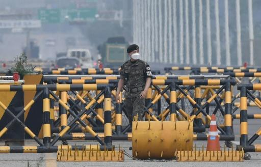 A South Korean soldier stands at a checkpoint on the Tongil bridge near the Demilitarized Zone (DMZ) dividing the two Koreas
