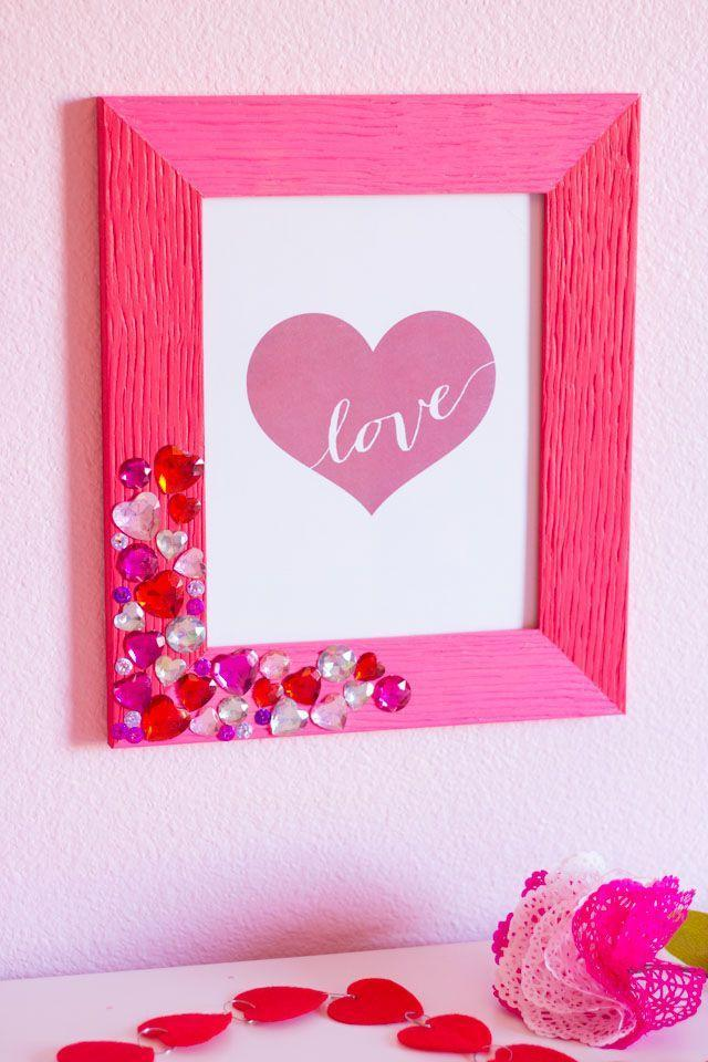 """<p>That macaroni picture frame has nothin' on this bedazzled beauty. If you're giving it as a gift, swap the cute graphic for a photo of you and your sweetheart(s). </p><p><em><a href=""""https://designimprovised.com/2016/02/diy-valentine-jewel-picture-frame.html"""" rel=""""nofollow noopener"""" target=""""_blank"""" data-ylk=""""slk:Get the tutorial at Design Improvised »"""" class=""""link rapid-noclick-resp"""">Get the tutorial at Design Improvised »</a></em></p>"""