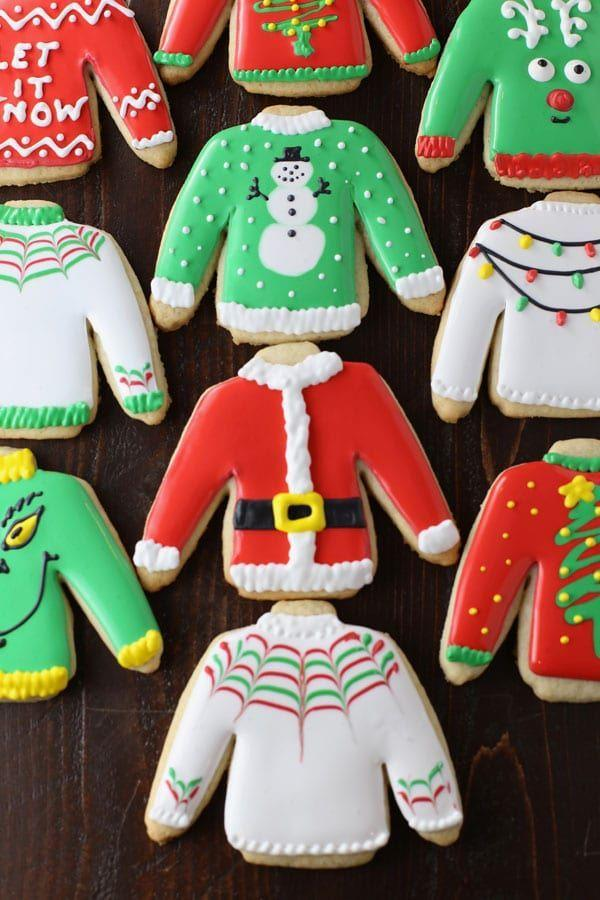 """<p>Now you don't have to wear an <a href=""""https://www.countryliving.com/shopping/g3915/christmas-sweaters/"""" rel=""""nofollow noopener"""" target=""""_blank"""" data-ylk=""""slk:ugly sweater"""" class=""""link rapid-noclick-resp"""">ugly sweater</a> to the holiday party—you can bring an edible version. Another idea is to turn this into a family game. Whoever creates the ugliest sweater on a plain cut-out is the winner!</p><p><strong>Get the recipe at <a href=""""https://www.momlovesbaking.com/ugly-sweater-christmas-cut-out-sugar-cookies/"""" rel=""""nofollow noopener"""" target=""""_blank"""" data-ylk=""""slk:Mom Loves Baking"""" class=""""link rapid-noclick-resp"""">Mom Loves Baking</a>.</strong></p><p><a class=""""link rapid-noclick-resp"""" href=""""https://www.amazon.com/Christmas-Sweater-Cookie-Cutter-Piece/dp/B07HLJJ1QS/?tag=syn-yahoo-20&ascsubtag=%5Bartid%7C10050.g.647%5Bsrc%7Cyahoo-us"""" rel=""""nofollow noopener"""" target=""""_blank"""" data-ylk=""""slk:SHOP SWEATER COOKIE"""">SHOP SWEATER COOKIE</a></p>"""
