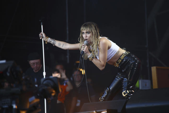 FILE - Singer Miley Cyrus performs on the final day of Glastonbury Festival at Worthy Farm, Somerset, England, on June 30, 2019. Cyrus turns 28 on Nov. 23. (Photo by Joel C Ryan/Invision/AP, File)