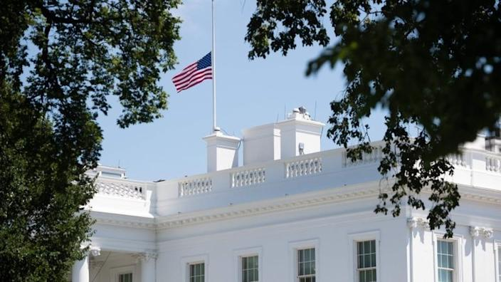 The flag flies at half mast over the White House