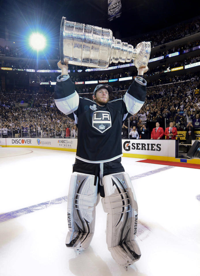 Los Angeles Kings goalie Jonathan Quick holds up the Stanley Cup after the Kings beat the New Jersey Devils 6-1during Game 6 of the NHL hockey Stanley Cup finals, Monday, June 11, 2012, in Los Angeles. (AP Photo/Mark J. Terrill)