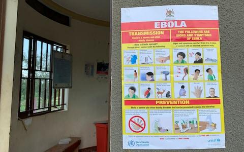 An Ebola-prevention information sign at the Ndaiga Health Centre II, near the shores of Lake Albert and the border with Congo, in Kagadi district, western Uganda - Credit: Ben Wise /International Rescue Committee