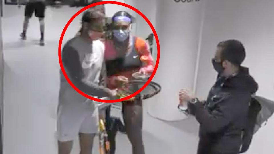 Pictured here, Serena Williams walks up to Rafael Nadal in the tunnel for a quick chat.