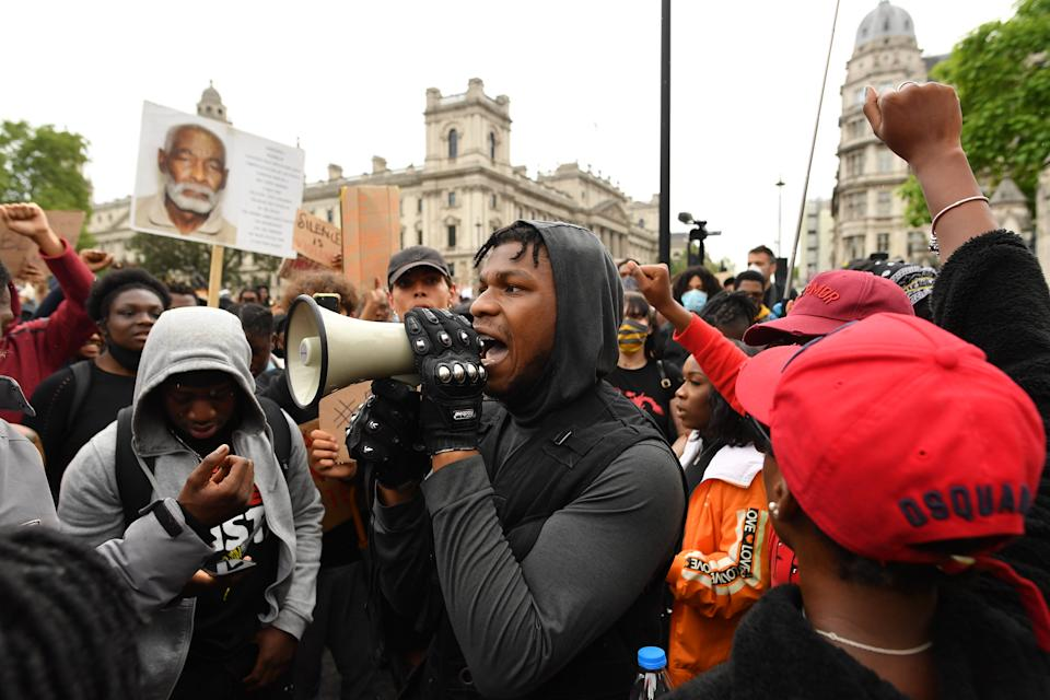 LONDON, ENGLAND - JUNE 03: Actor John Boyega speaks to the crowd during a Black Lives Matter protest in Hyde Park on June 3, 2020 in London, United Kingdom.  The death of an African-American man, George Floyd, while in the custody of Minneapolis police has sparked protests across the United States, as well as demonstrations of solidarity in many countries around the world. (Photo by Justin Setterfield/Getty Images)