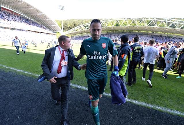 "Soccer Football - Premier League - Huddersfield Town vs Arsenal - John Smith's Stadium, Huddersfield, Britain - May 13, 2018 Arsenal's David Ospina walks off the pitch at the end of the match REUTERS/Peter Powell EDITORIAL USE ONLY. No use with unauthorized audio, video, data, fixture lists, club/league logos or ""live"" services. Online in-match use limited to 75 images, no video emulation. No use in betting, games or single club/league/player publications. Please contact your account representative for further details."