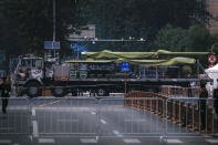 In this Saturday, Sept. 21, 2019, photo, a Chinese military vehicle possibly carrying a drone passes along the Jianguomenwai Avenue during a rehearsal for the 70th anniversary of Communist China, in Beijing. A parade on Tuesday, Oct. 1 by China's secretive military will offer a rare look at its rapidly developing arsenal, including possibly a nuclear-armed missile that could reach the United States in 30 minutes, as Beijing gets closer to matching Washington and other powers in weapons technology. (AP Photo/Andy Wong)