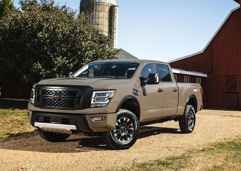 "<p>Between half-ton and three-quarter-ton full-size pickups, Nissan has positioned <a href=""https://www.caranddriver.com/nissan/titan-xd"" rel=""nofollow noopener"" target=""_blank"" data-ylk=""slk:Titan XD"" class=""link rapid-noclick-resp"">Titan XD</a>. The most capable off-roader among the Titan XD's lineup is the Pro-4X. Leveraging the XD's ladder-frame chassis, the Pro-4x features specifically tuned Bilstein dampers, a two-speed transfer case, an electronic locking rear differential, hill-descent control, and knobby all-terrain tires. The exterior gets a brazen bed-side decal, black tow hooks up front, red accents, and a different grille. The standard engine is the familiar 5.6-liter V-8 rated at 400 horsepower.</p>"