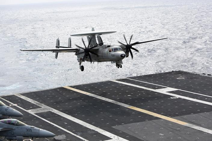 A U.S. Navy E-2C Hawkeye aircraft prepares to land on the deck of the nuclear-powered USS George Washington (CVN73) off southern coast of Vietnam in South China Sea Saturday, Oct. 20, 2012. A U.S. aircraft carrier group cruised through the disputed South China Sea on Saturday in a show of American power in waters that are fast becoming a focal point of Washington's strategic rivalry with Beijing. (AP Photo/Na Son Nguyen)