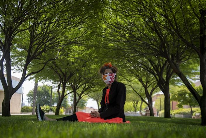 "Activist Albia Miller sits under a canopy of shade trees at the Menifee Valley campus of Mt. San Jacinto College. <span class=""copyright"">(Gina Ferazzi / Los Angeles Times)</span>"