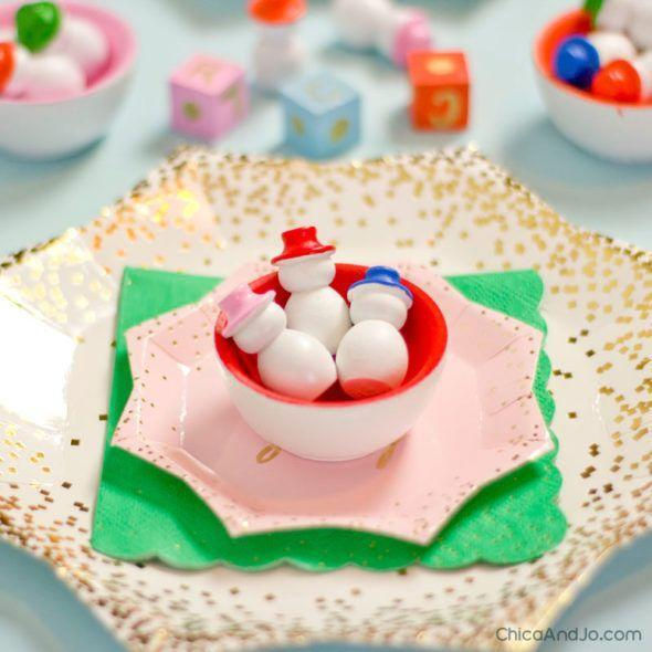 "<p>This little game of chance is as much for kids at the children's table to play as it is for the whole family to make.</p><p><strong>Get the tutorial at <a href=""https://www.chicaandjo.com/christmas-snowman-game-for-the-kids-table/"" rel=""nofollow noopener"" target=""_blank"" data-ylk=""slk:Chica and Jo"" class=""link rapid-noclick-resp"">Chica and Jo</a>.</strong></p><p><a class=""link rapid-noclick-resp"" href=""https://www.amazon.com/s?k=americana+acrylic+paint+multi+surface+white&ref=nb_sb_noss_2&tag=syn-yahoo-20&ascsubtag=%5Bartid%7C10050.g.22825300%5Bsrc%7Cyahoo-us"" rel=""nofollow noopener"" target=""_blank"" data-ylk=""slk:SHOP WHITE MULTI-SURFACE PAINT"">SHOP WHITE MULTI-SURFACE PAINT</a><br></p>"
