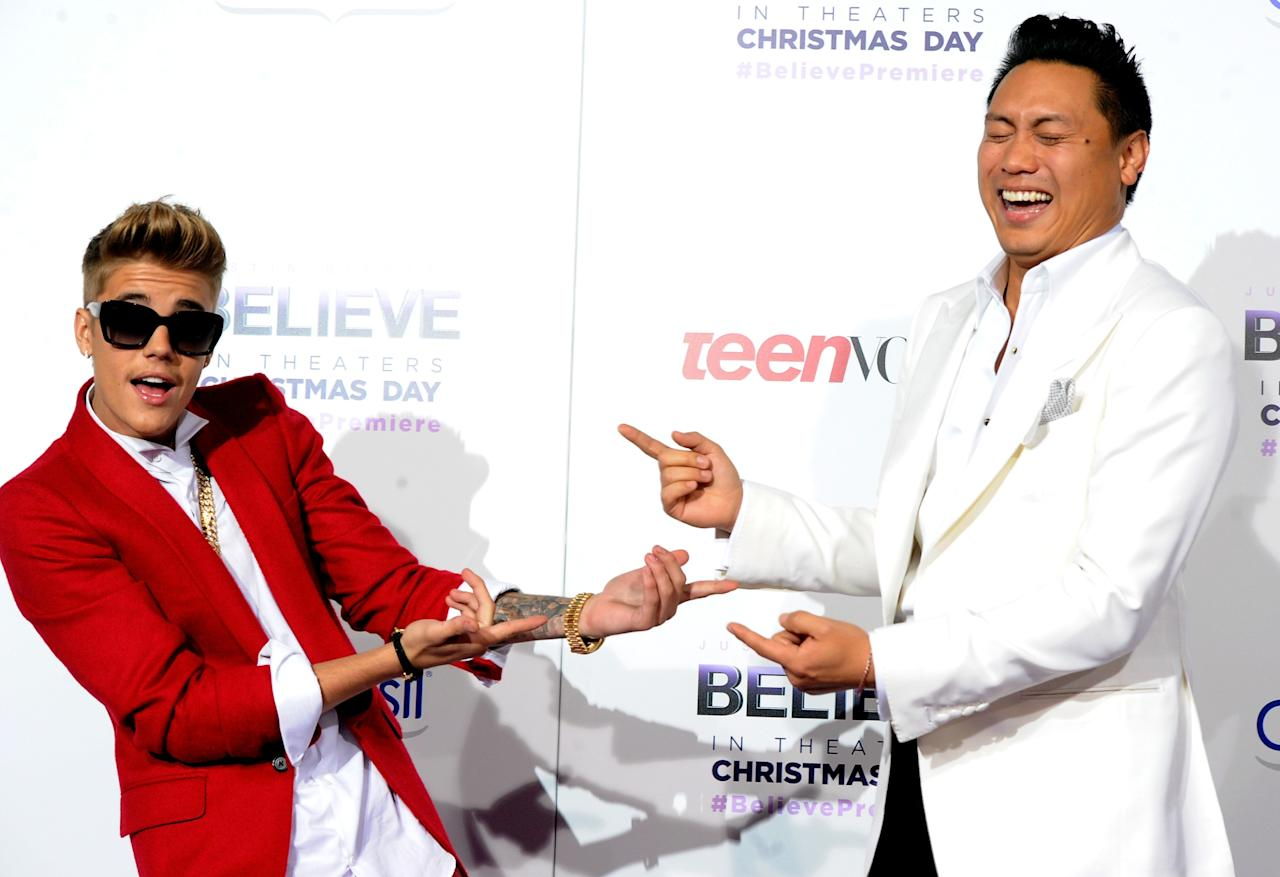 "LOS ANGELES, CA - DECEMBER 18: Singer/producer Justin Bieber (L) and director Jon M. Chu arrive at the premiere Of Open Road Films' ""Justin Bieber's Believe"" at Regal Cinemas L.A. Live on December 18, 2013 in Los Angeles, California. (Photo by Kevin Winter/Getty Images)"