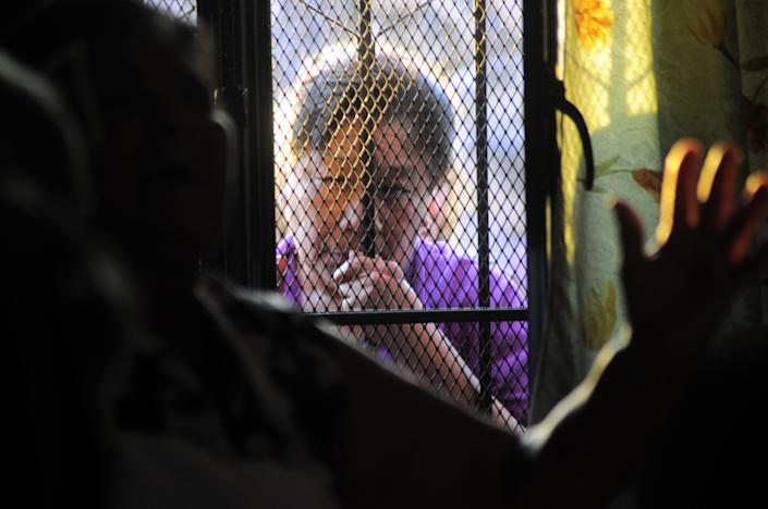 An unidentified person stands at the entrance to the home of the parents of Texas death-row inmate Edgar Tamayo in Miacatlan, Mexico, Wednesday, Jan. 22, 2014. The Mexican national was executed Wednesday night in Texas for killing a Houston police officer, despite pleas and diplomatic pressure from the Mexican government and the U.S. State Department to halt the punishment. Tamayo, 46, received a lethal injection for the January 1994 fatal shooting of Officer Guy Gaddis, 24. (AP Photo/Tony Rivera)
