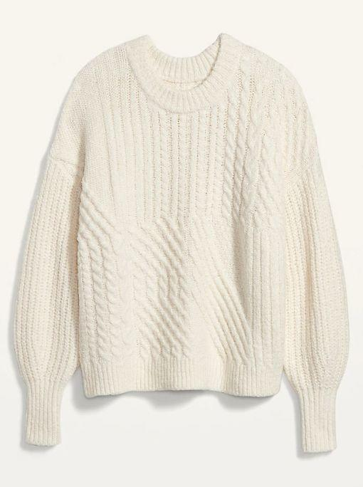 """This Cozy Cable-Knit Blouson-Sleeve Sweater for Women is available in sizes XS to XXL and five colors. <a href=""""https://fave.co/36qMI7R"""" target=""""_blank"""" rel=""""noopener noreferrer"""">Get it on sale for 50% off (normally $45) at Old Navy</a>."""