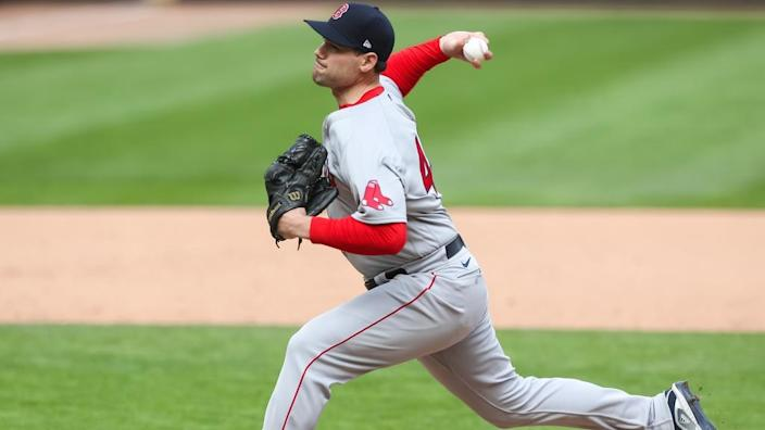 Apr 15, 2021; Minneapolis, Minnesota, USA; Boston Red Sox relief pitcher Adam Ottavino delivers a pitch against the Minnesota Twins in the ninth inning at Target Field.