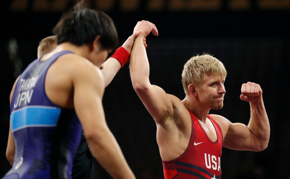 FILE - In this April 7, 2018, file photo, United States' Kyle Dake, right, celebrates after defeating Japan's Sohsuke Takatani, left, in a 79kg match in the Freestyle Wrestling World Cup in Iowa City, Iowa. Dake finally broke through at age 30 at the U.S. Olympic Trials and qualified for Tokyo at 74 kilograms. (AP Photo/Charlie Neibergall, File)