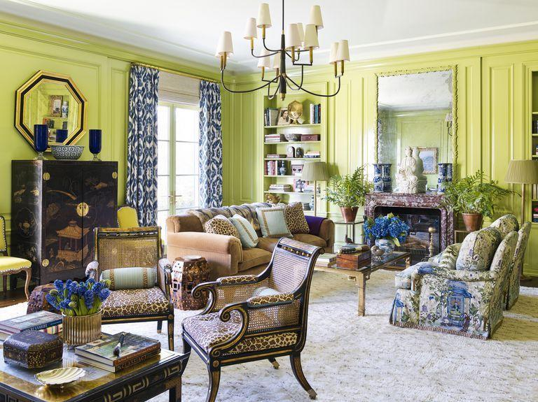 """<p>Electric chartreuse walls do all the talking in the library of <a href=""""https://www.veranda.com/decorating-ideas/a27105023/meg-braff-long-island-home/"""" rel=""""nofollow noopener"""" target=""""_blank"""" data-ylk=""""slk:Meg Braff's Long Island home"""" class=""""link rapid-noclick-resp"""">Meg Braff's Long Island home</a>. The bright shade by <a href=""""https://www.benjaminmoore.com/en-us/color-overview/find-your-color/color/538/vienna-green?color=538"""" rel=""""nofollow noopener"""" target=""""_blank"""" data-ylk=""""slk:Benjamin Moore"""" class=""""link rapid-noclick-resp"""">Benjamin Moore</a> ushers in natural light while accentuating the room's original 1960s paneling. <a href=""""http://www.megbraffdesigns.com/"""" rel=""""nofollow noopener"""" target=""""_blank"""" data-ylk=""""slk:Braff"""" class=""""link rapid-noclick-resp"""">Braff</a> covered the cushions of <a href=""""https://us.julianchichester.com/"""" rel=""""nofollow noopener"""" target=""""_blank"""" data-ylk=""""slk:Julian Chichester"""" class=""""link rapid-noclick-resp"""">Julian Chichester</a> cane-back armchairs in a leopard fabric by <a href=""""https://www.kravet.com/our-brands/brunschwig-fils"""" rel=""""nofollow noopener"""" target=""""_blank"""" data-ylk=""""slk:Brunschwig & Fils"""" class=""""link rapid-noclick-resp"""">Brunschwig & Fils</a>. <br></p>"""