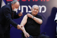 Israeli Prime Minister Minister Benjamin Netanyahu receives a coronavirus vaccine at Sheba Medical Center in Ramat Gan, Israel on Saturday, Dec. 19, 2020. (Amir Cohen/Pool via AP)