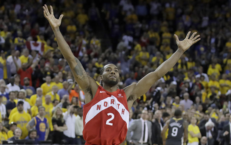 best sneakers e1065 0a746 Toronto Raptors forward Kawhi Leonard celebrates after the Raptors defeated  the Golden State Warriors in Game