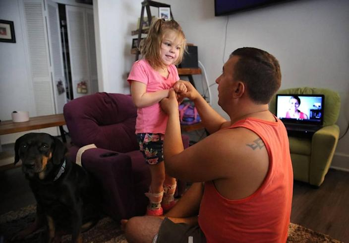 Firefighter Kyle Stromquist is a father figure and therapy partner to Brooklyn Grant.