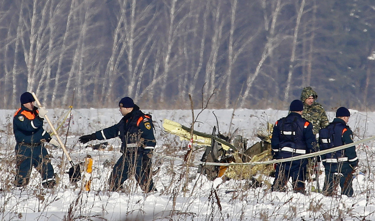 <p>Personnel work at the scene of a AN-148 plane crash in Stepanovskoye village, about 40 kilometers (25 miles) from the Domodedovo airport, Russia, Feb. 12, 2018. (Photo: Alexander Zemlianichenko/AP) </p>