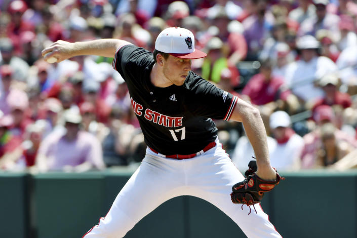 North Carolina State pitcher Sam Highfill (17) throws against Arkansas in the third inning of an NCAA college baseball super regional game Saturday, June 12, 2021, in Fayetteville, Ark. (AP Photo/Michael Woods)