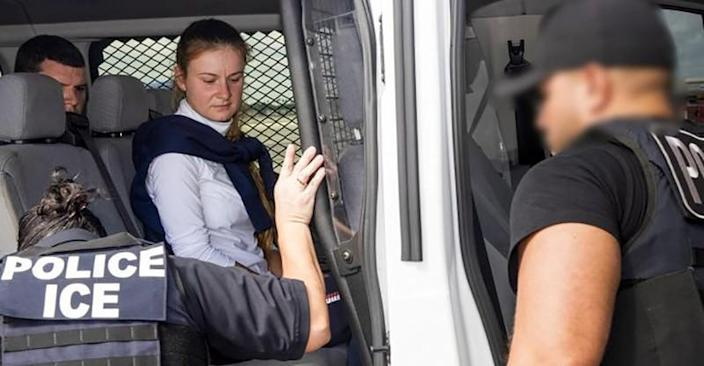 Convicted Russian agent Maria Butina is accompanied by federal agents after her release from a Florida prison