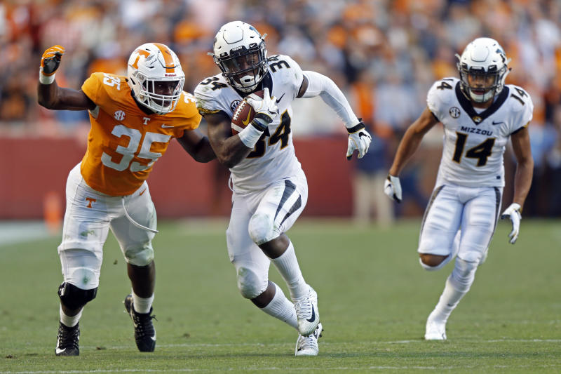 Missouri running back Larry Rountree III (34) runs for yardage as he's chased by Tennessee linebacker Daniel Bituli (35) in the first half of an NCAA college football game Saturday, Nov. 17, 2018, in Knoxville, Tenn. (AP Photo/Wade Payne)