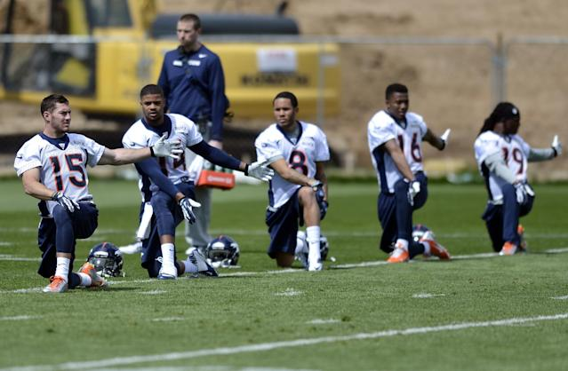 Denver Broncos' Greg Wilson (15), Cody Latimer (14), Devin Aguilar (8), Bennie Fowler (16) and Isaiah Burse (19) stretch during NFL football rookie camp, Friday, May 16, 2014, in Englewood, Colo. (AP Photo/Jack Dempsey)
