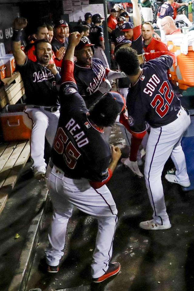 Washington Nationals' Victor Robles celebrates with teammates after hitting a home run during the sixth inning of Game 3 of the baseball National League Championship Series against the Washington Nationals Monday, Oct. 14, 2019, in Washington. (AP Photo/Jeff Roberson)