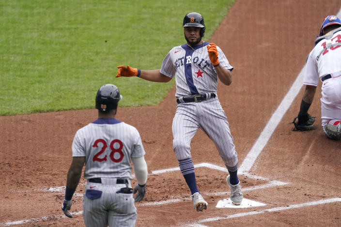 Detroit Tigers' Jeimer Candelario runs home to score on an RBI single by Eric Haase during the first inning of a baseball game against the Kansas City Royals Sunday, May 23, 2021, in Kansas City, Mo. (AP Photo/Charlie Riedel)