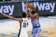 Brooklyn Nets' James Harden, right, shoots over San Antonio Spurs' Devin Vassell during the second half of an NBA basketball game Wednesday, May 12, 2021, in New York. (AP Photo/Frank Franklin II)