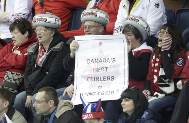 Fans of Canada cheer during their men's curling round robin game against Russia at the 2014 Sochi Olympics in the Ice Cube Curling Center in Sochi February 12, 2014. REUTERS/Ints Kalnins (RUSSIA - Tags: SPORT OLYMPICS SPORT CURLING)