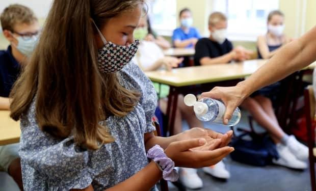 An official with the Saskatchewan Health Authority is calling on school divisions in the province to have the same restrictions and masking rules as last year.  (Fabrizio Bensch/Reuters - image credit)