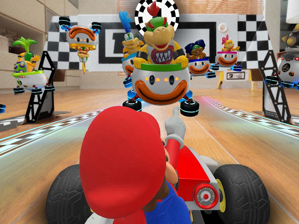 Mario's car, racetrack and opponents overlay live footage of your living roomNintendo