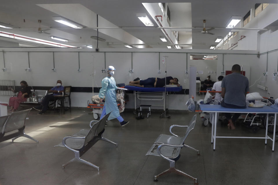 COVID-19 patients are cared for in an area that was improvised to accommodate more patients at the public HRAN Hospital in Brasilia, Brazil, Monday, March 8, 2021. (AP Photo/Eraldo Peres)