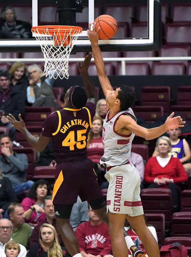 Stanford forward Oscar da Silva (13) blocks Arizona State forward Zylan Cheatham (45) during the first half of an NCAA college basketball game in Stanford, Calif., Saturday, Jan. 12, 2019. (AP Photo/Tony Avelar)