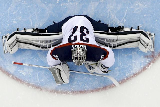 USA goaltender Jonathan Quick stretches tp block a shot on goal during the first period of men's quarterfinal hockey game against the Czech Republic in Shayba Arena at the 2014 Winter Olympics, Wednesday, Feb. 19, 2014, in Sochi, Russia. (AP Photo/Matt Slocum)