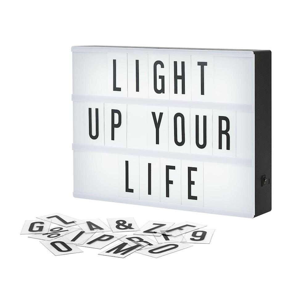 """<p><strong>My Cinema Lightbox</strong></p><p>amazon.com</p><p><strong>$29.99</strong></p><p><a href=""""https://www.amazon.com/dp/B0167XQQHO?tag=syn-yahoo-20&ascsubtag=%5Bartid%7C10065.g.29844066%5Bsrc%7Cyahoo-us"""" rel=""""nofollow noopener"""" target=""""_blank"""" data-ylk=""""slk:Shop Now"""" class=""""link rapid-noclick-resp"""">Shop Now</a></p><p>The perfect item to jazz up any room, this LED lightbox is totally customizable and easy to use.</p>"""