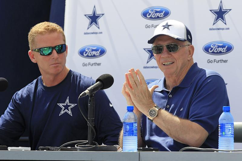 Jason Garrett is surely familiar by now with Jerry Jones addressing his job status. (AP/File)